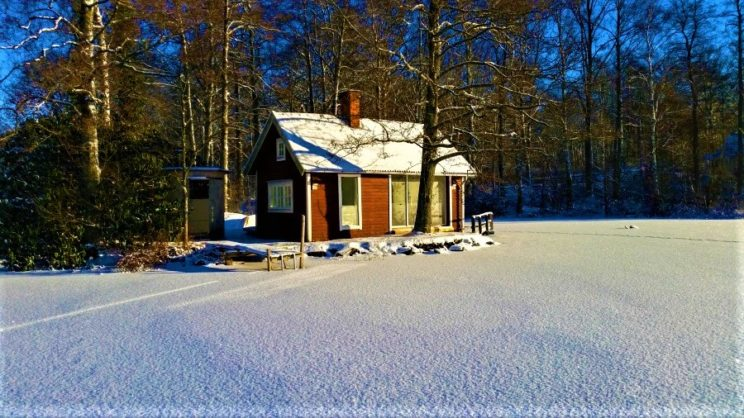 swedish cottage winter snow